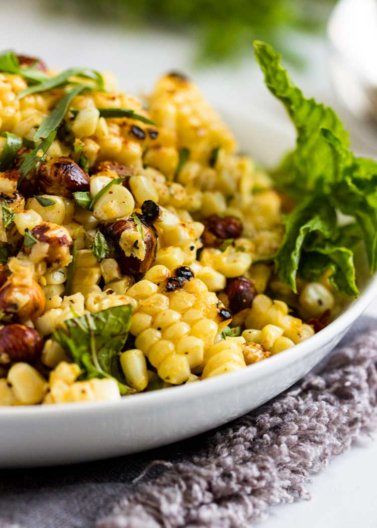 A fantastic Grilled Corn Salad with Hazelnuts is our family summer salad favorite. The citrus, mint and tarragon vinaigrette makes it! Super easy, so good. keviniscooking.com