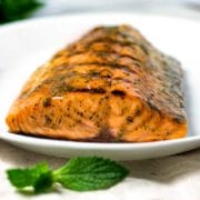 This Honey Mustard Grilled Salmon is super easy quick and healthy. A honey, mustard and dried mint sauce bastes after grilling. Perfect mid-week dinner everyone loves. www.keviniscooking.com