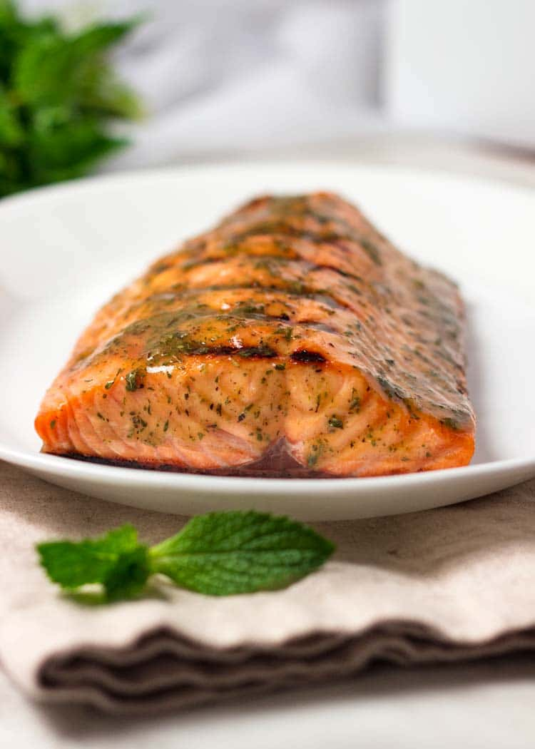 For this Honey Mustard Grilled Salmon, brush on this simple yet flavorful sauce of honey, mustard, mint and horseradish for a little kick after grilling. keviniscooking.com