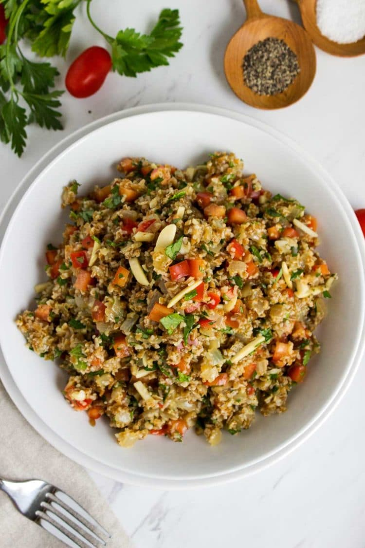 A Orange Bulgur Wheat Salad that knocks your socks off. Fresh mint and toasted almonds make this a new twist on the traditional Tabbouleh. www.keviniscooking
