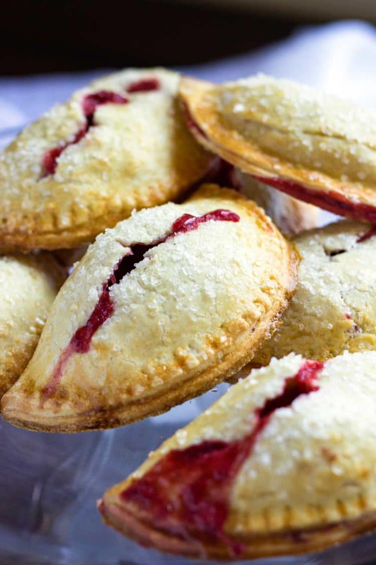 These Rhubarb Baked Empanadas are baked, not fried and the lightly sweet, flakey dough is just perfect to hold the chopped rhubarb and strawberries. Perfect for the kids and picnics. www.keviniscooking.com