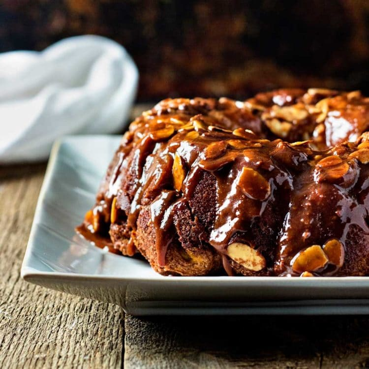 This Chocolate Caramel Monkey Bread is made with refrigerated biscuit dough and few pantry ingredients, Wrap, dunk, roll and bake - you're set! www.keviniscooking.com