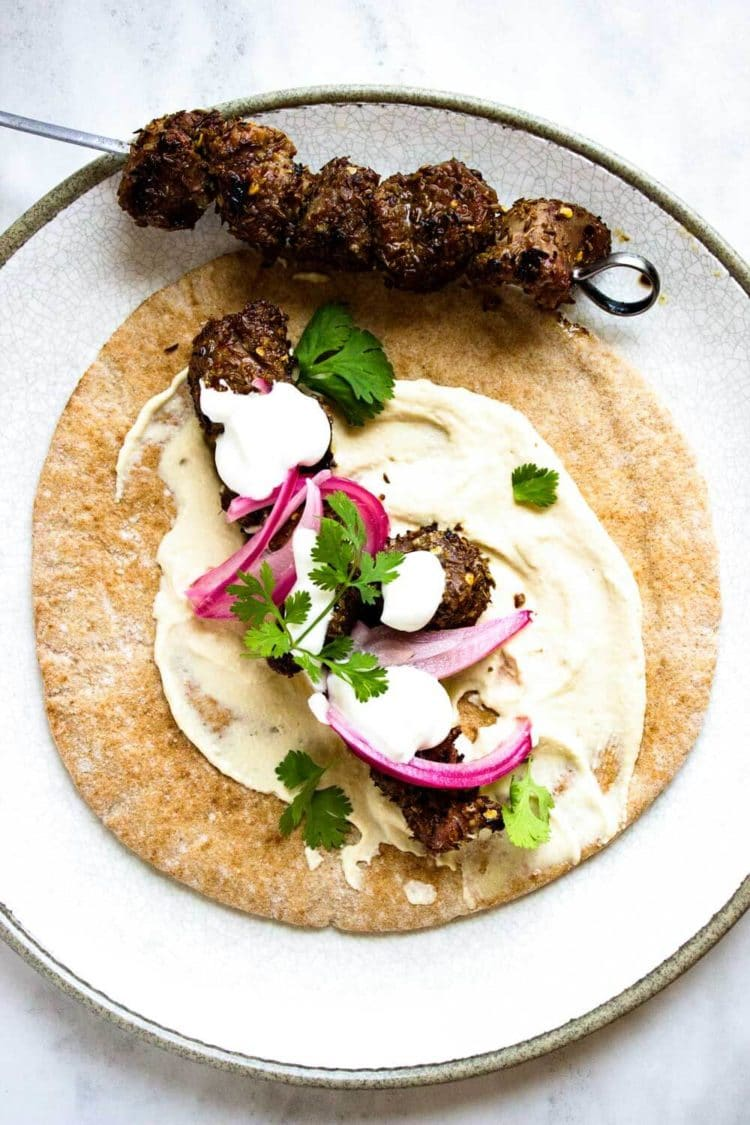 These Cumin Chile Lamb Kabobs are spiced up, grilled and stuff a hummus filled pita topped with a lemon garlic yogurt sauce. They were gone in no time! www.keviniscooking.com