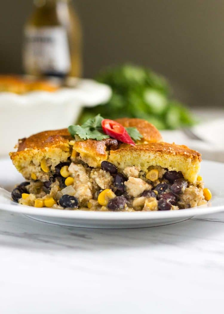 Easy Chicken Tamale Pie - made from ground chicken, spices, corn and beans all topped with a cornbread batter that's baked and ready in minutes. A house favorite! www.keviniscooking.com