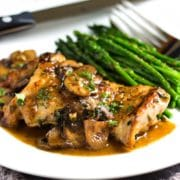 This Quick Pan Seared Chicken is smothered in a luscious, lemony mushroom pan sauce and on the table in 30 minutes. I serve with steamed vegetables and it's so good! Family loves it. www.keviniscooking.com