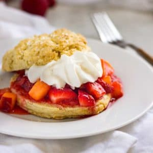 A plate of food on a table, strawberry shortcakes