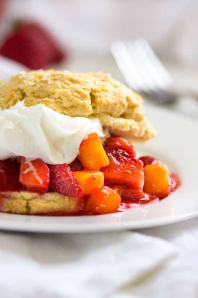Peach and Strawberry Shortcake is the perfect dessert to end a Summer family dinner. Fresh fruit, light and crumbly shortcake all topped with whipped cream… a sure hit every time! www.keviniscooking.com