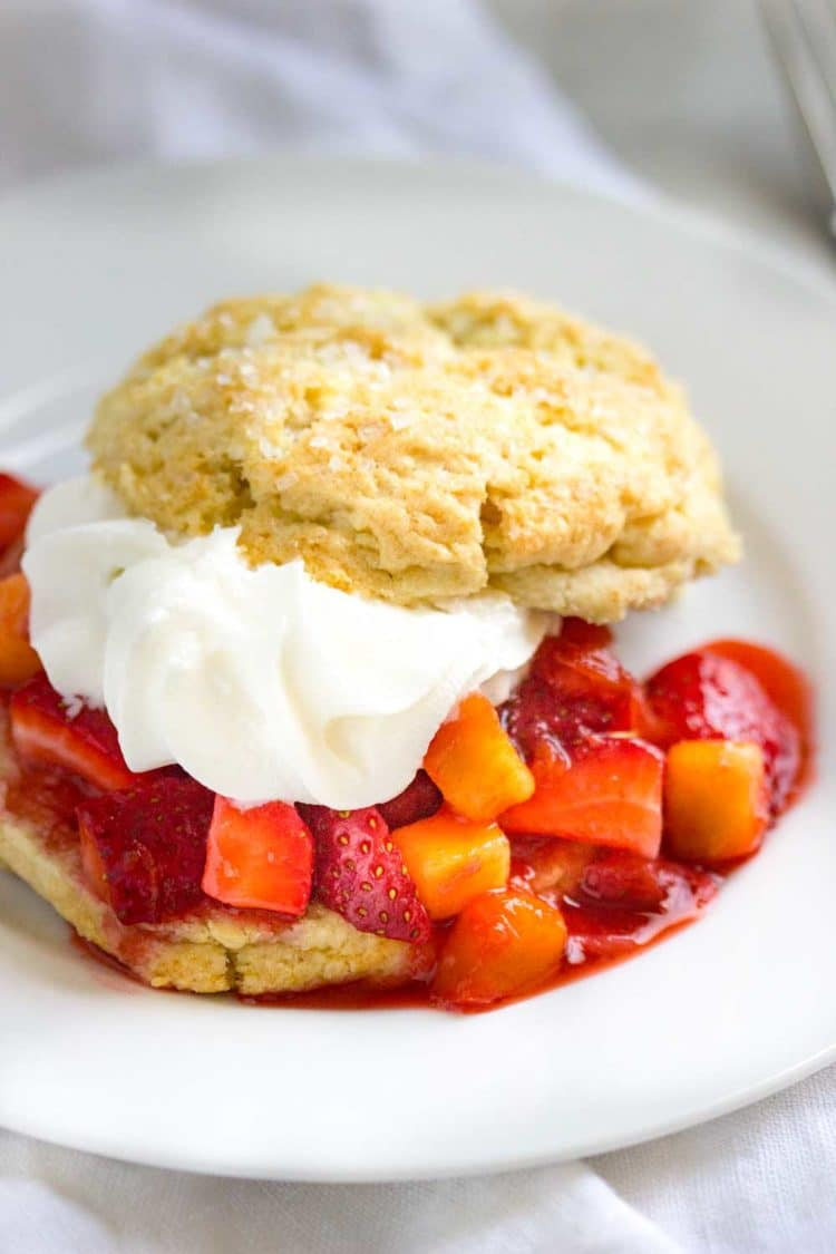 Peach and Strawberry Shortcakes are the perfect dessert to end a Summer family dinner. Fresh fruit, light and crumbly shortcake all topped with whipped cream… a sure hit every time! www.keviniscooking.com