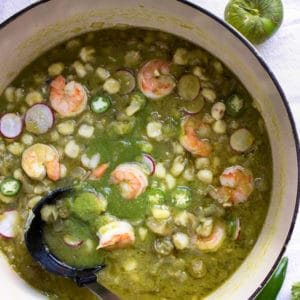 This Shrimp Posole Verde starts with a traditional, hearty Mexican soup that eats like a stew, and includes hominy, chiles and substitutes shrimp for pork. So good!