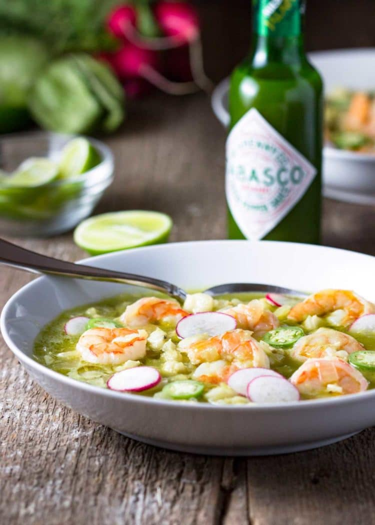 This Shrimp Posole Verde starts with a traditional, hearty Mexican soup that eats like a stew, and includes hominy, chiles and substitutes shrimp for pork. So good! #TabascoTastemakers #spon www.keviniscooking.com