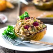 Call it stuffing or dressing, these Savory Stuffed Acorn Squash have a sausage sourdough bread stuffing with pecans and cranberries that doesn't need a holiday to be eaten. We eat these whenever rI can get fresh acorn squash. Amazing stuffing! www.keviniscooking.com