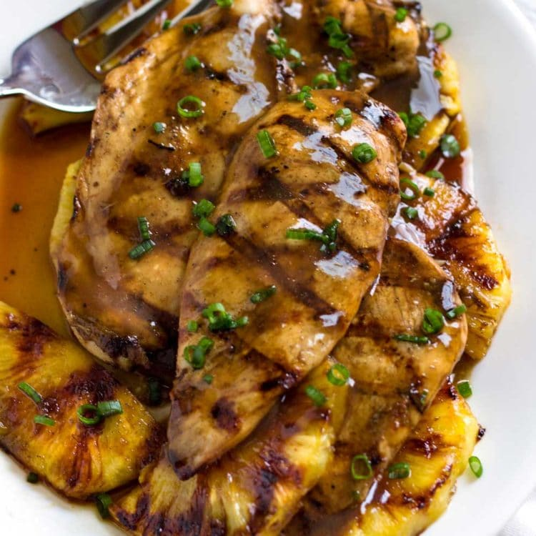 With Caribbean influences this Tropical Pineapple Chicken recipe uses a marinade turn glaze, reminiscent of a jerk sauce. Grilled or baked recipe versions! www.keviniscooking.com