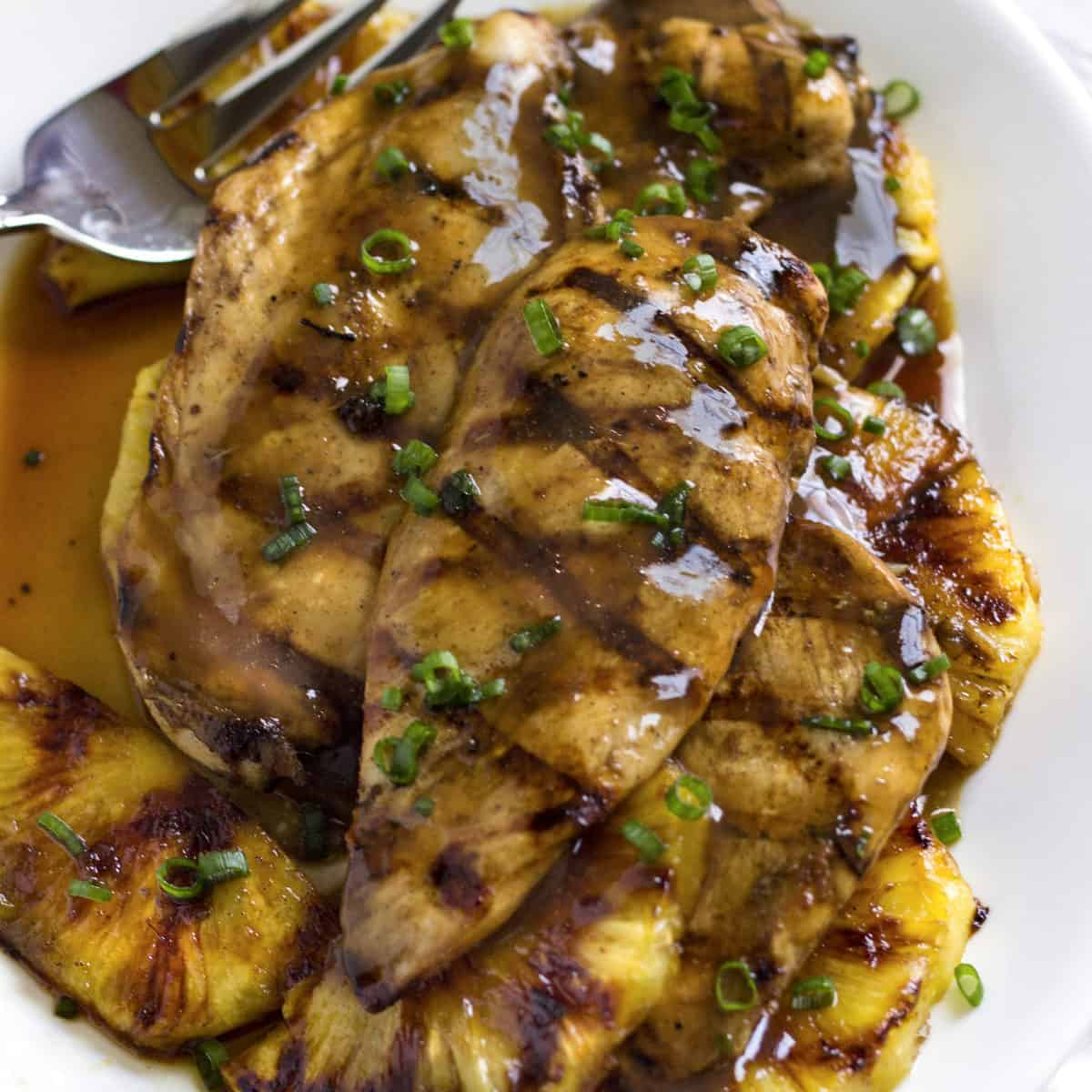 grilled pineapple and chicken with sauce and green onions