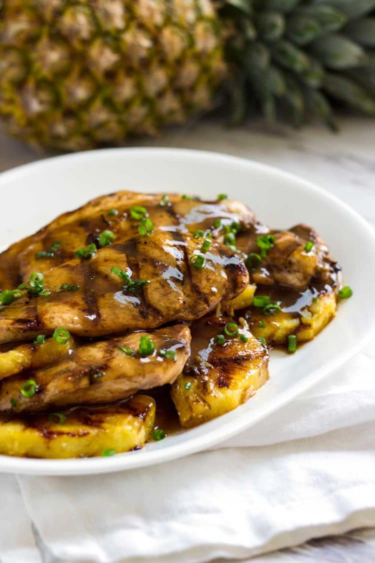 With Caribbean influences this Tropical Pineapple Chicken recipe uses a marinadeturn glaze, reminiscent of a jerk sauce. Grilled or baked recipe versions! www.keviniscooking.com