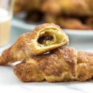 These super easy breakfast or dessert hand held Cinnamon Glazed Chocolate Crescents are made with refrigerated dough, chocolate chips and rolled in cinnamon sugar. These go quick and are a house favorite! www.keviniscooking.com
