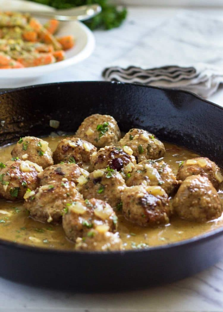 Super moist, tender and packed with flavor, these Cranberry Turkey Meatballs are great any time of year! A quick pan sauce coats them, easily serve as an appetizer or with a side for a meal. Not dried out lumps, these meatballs are beyond and a family favorite! www.keviniscooking.com