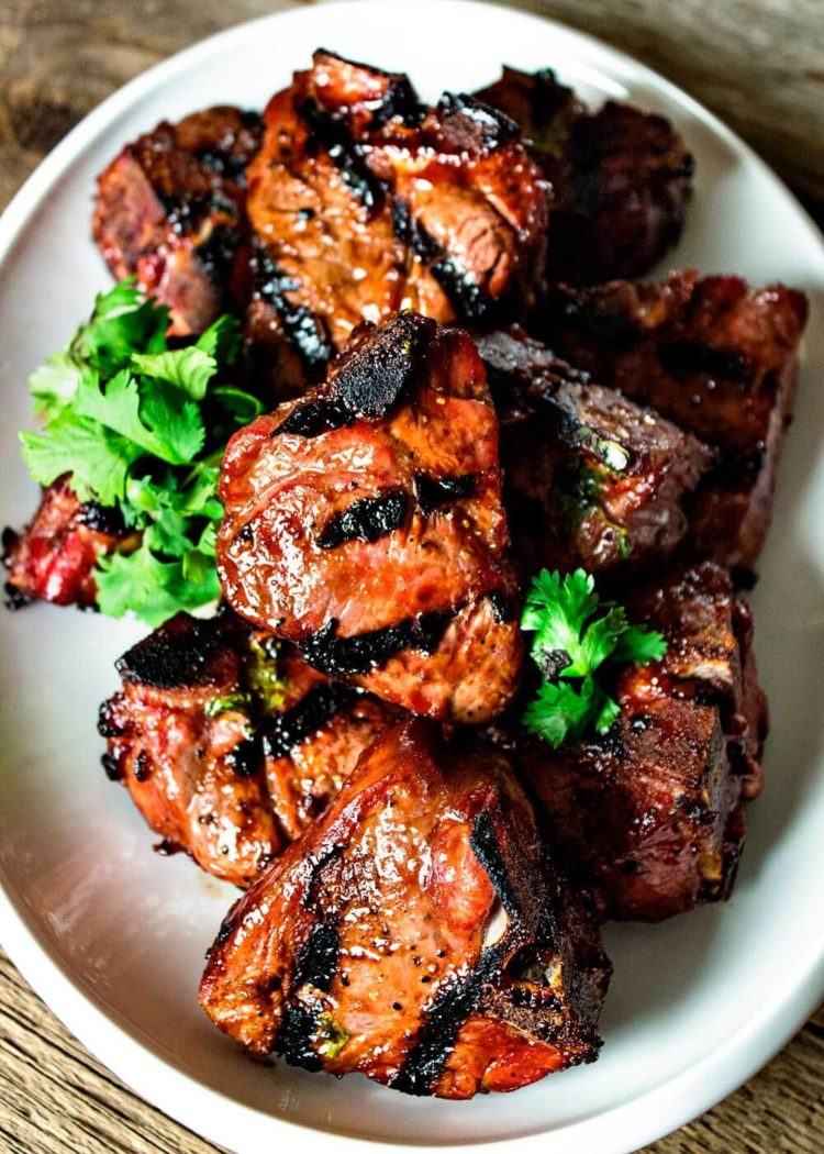 Hoisin sauce is a thick, pungent sauce primarily made with black bean paste and Chinese Five Spice powder. Here it's glazing grilled lamb loin chops and served with chopped cilantro. www.keviniscooking.com