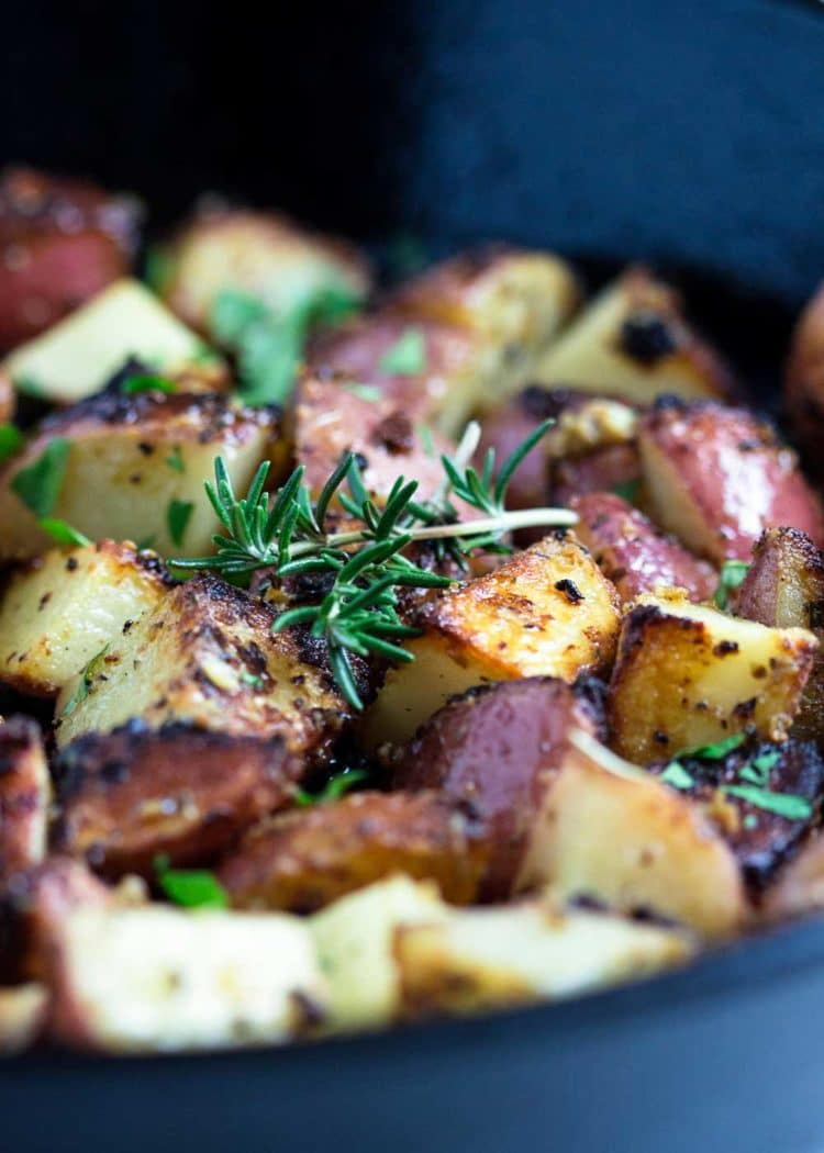 These Herb Roasted Poupon Potatoes couldn't be any easier. Caramelized red potatoes that are crispy on the outside all coated with a tangy sauce. www.keviniscooking.com