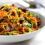 This Honey Mustard Sweet Potato Salad is made with with spiralized sweet potatoes, zucchini and shaved brussels sprouts in a bacon honey mustard dressing that is off the hook in taste and made in no time! www.keviniscooking.com