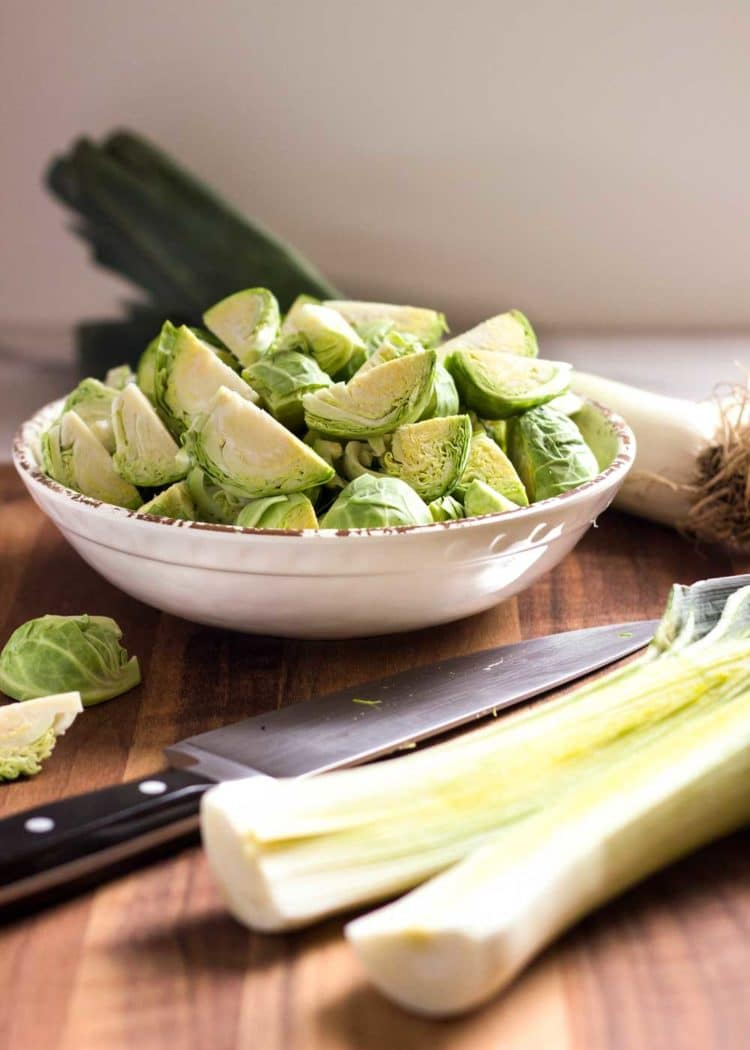 These Pan Roasted Brussels Sprouts are served crispy, browned and get a flavor boost from sliced leeks cooked with butter, fresh ginger and lime zest. www.keviniscooking.com