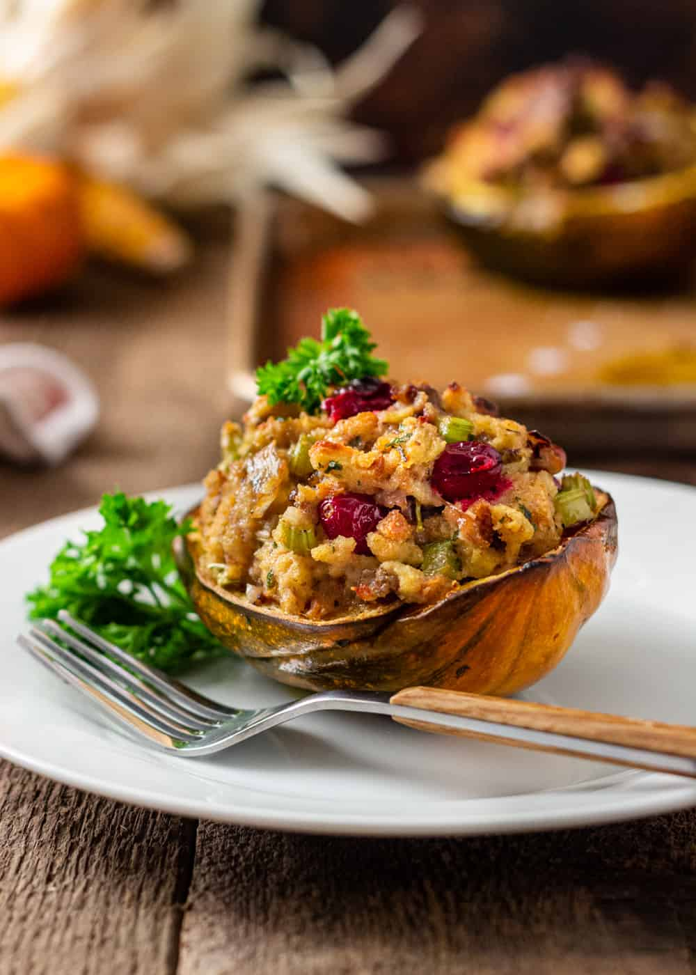 plated dinner of sausage stuffed acorn squash