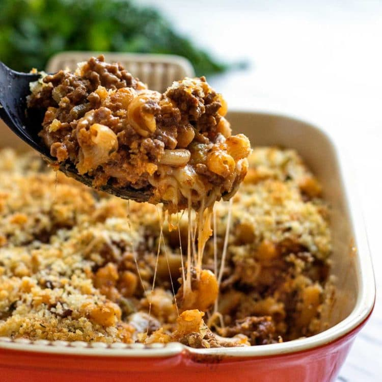 Mac and Cheese is an American classic comfort food and in this Beefy Mac and Cheese Casserole it goes a step further with a Mexican salsa addition to ground beef and a crunchy breadcrumb topping. www.keviniscooking.com