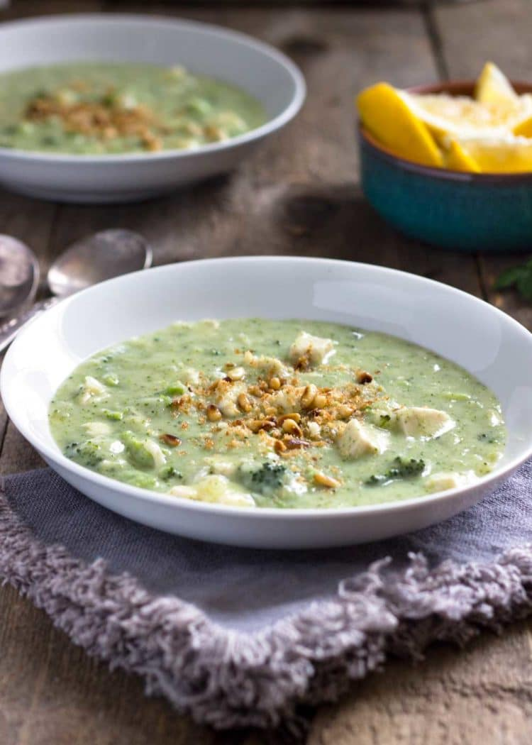 This Cream of Broccoli Soup with Chicken uses less butter and cream, is loaded with fresh broccoli and savory chicken. The pine nut breadcrumb topping sets it off and is pure comfort food. www.keviniscooking.com