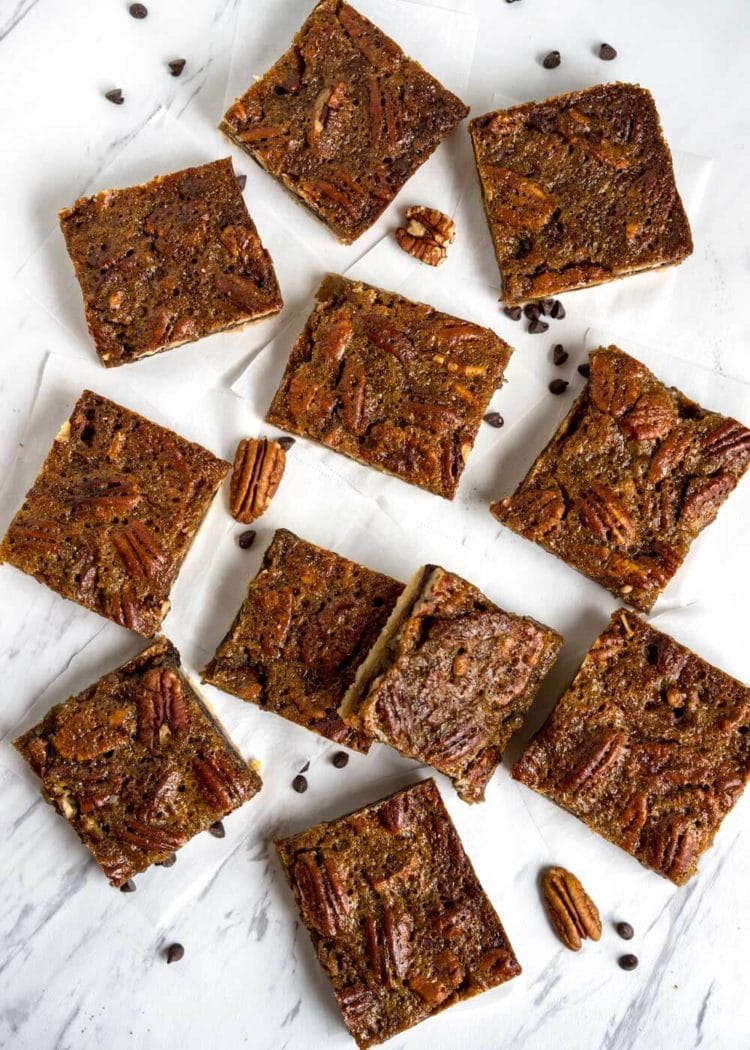 Slab Pecan Pie Bars! Imagine all the richness of a slice of pecan pie but with a layer of melted chocolate in between that luscious pecan pie filling and flaky dough crust in bar form. Perfect for large crowds, holiday family get togethers… No dishes to clean up after either. www.keviniscooking.com