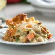 This turkey pot pie has a golden brown puff pastry pie shell, get's filled with chucks of turkey and veggies, all in a creamy, savory sauce using no cream! www.keviniscooking.com