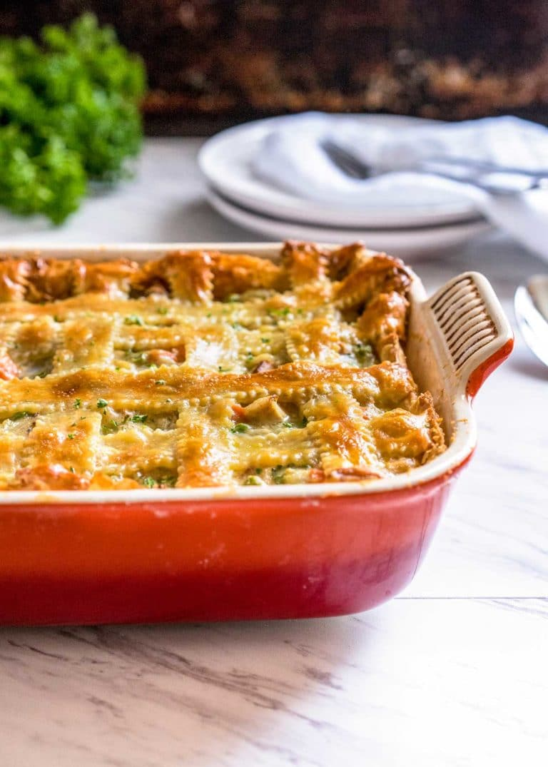 baked turkey casserole with golden brown puff pastry top