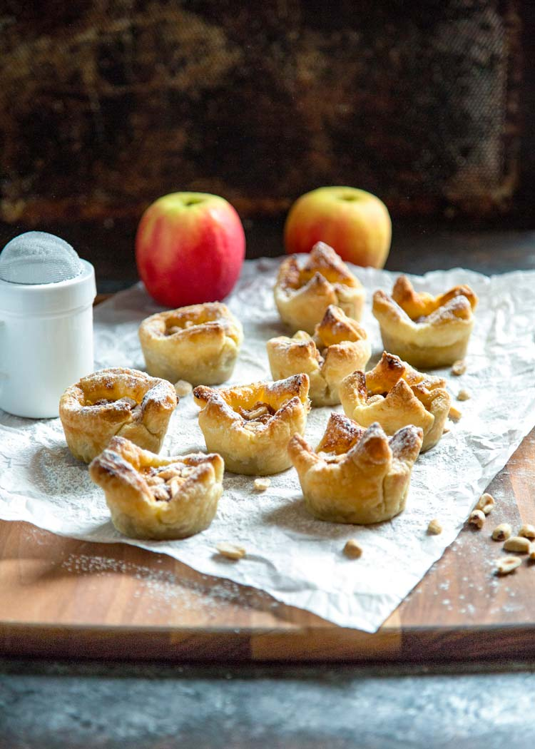 An incredible combination of flavors, these Apple Peanut Butter Tarts have it all. Puff pastry encases peanut butter, topped with diced apples, a dab of apple butter and peanuts. Baked to a golden delicious, no pun intended, finish, these are the best little desserts that deliver big on flavor. www.keviniscooking.com