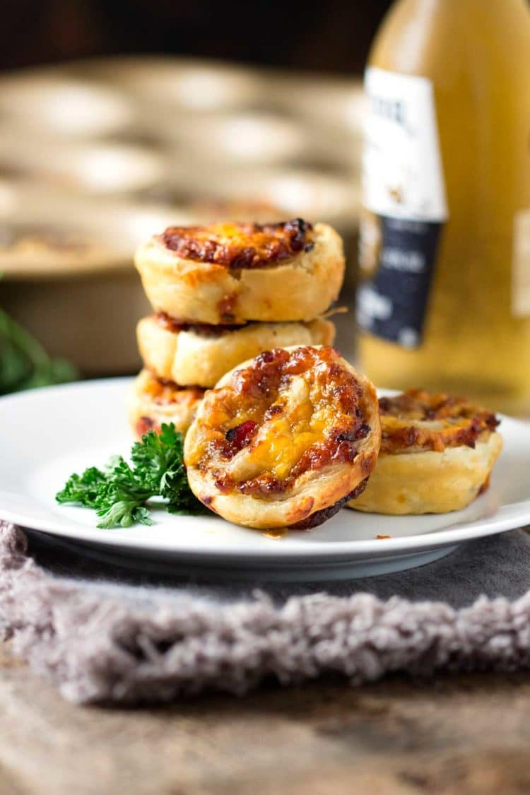 Talk about complex and multi-layered flavors, these Cheddar Bacon Jam Puff Pastry Bites are made with bacon, onions, figs and a variety of other ingredients that make up the perfect, handheld appetizer. keviniscooking.com