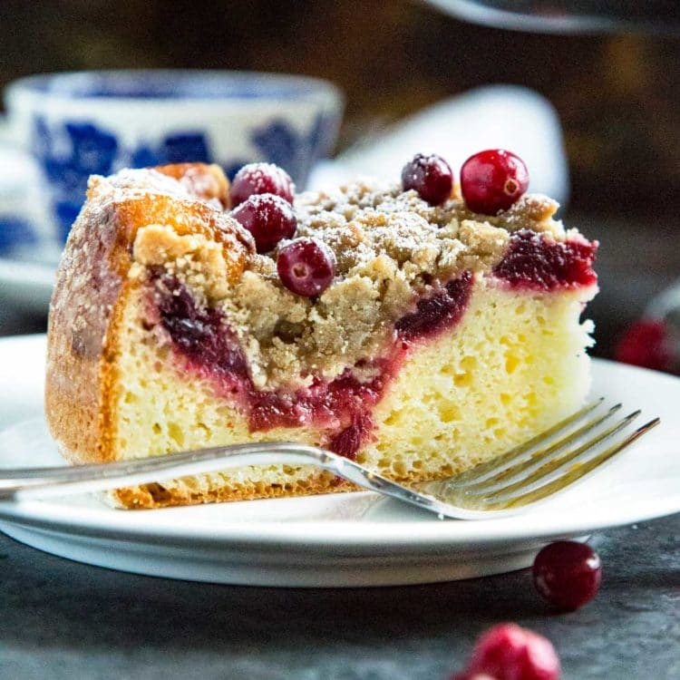 This Cranberry Coffee Cake has a brown sugar streusel that's a crumbly and sweet contrast to the tangy cranberry jam that tops this super moist coffee cake. www.keviniscooking.com