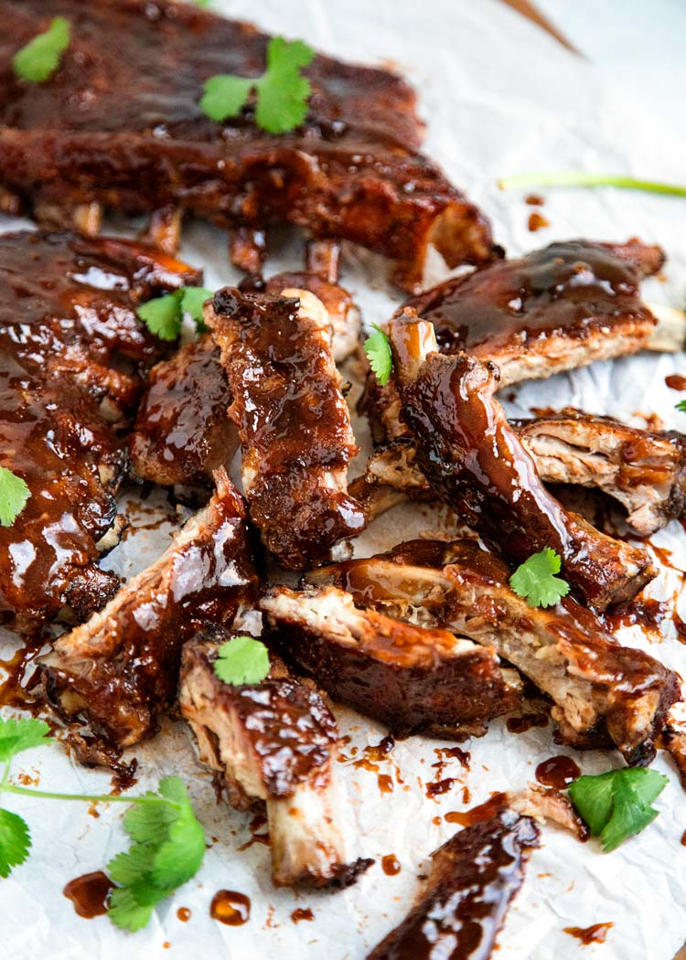 Talk about finger lickin' good, these Slow Cooker Sweet and Sour Sticky Ribs are fall off the bone tender and coated in a spectacular Asian inspired sweet and sour sauce. www.keviniscooking.com