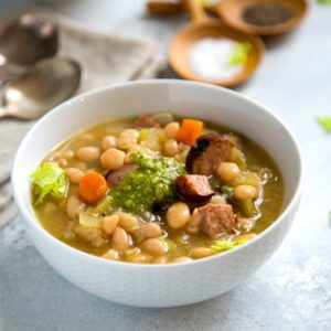 This Slow Cooker White Bean Soup has added beef kielbasa sausage for a heartier meal. Grilled or pan seared for that added caramelization flavor, plus a touch of fresh pesto tops it all before serving. www.keviniscooking.com
