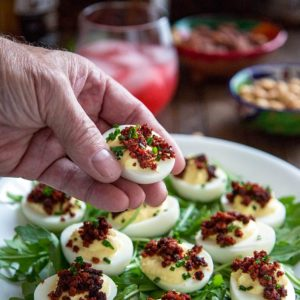 These Crispy Chorizo Deviled Eggs are deliciously smoky in flavor and get a boost in creaminess from Greek yogurt, lemon zest and have a crunchy topping. keviniscooking.com
