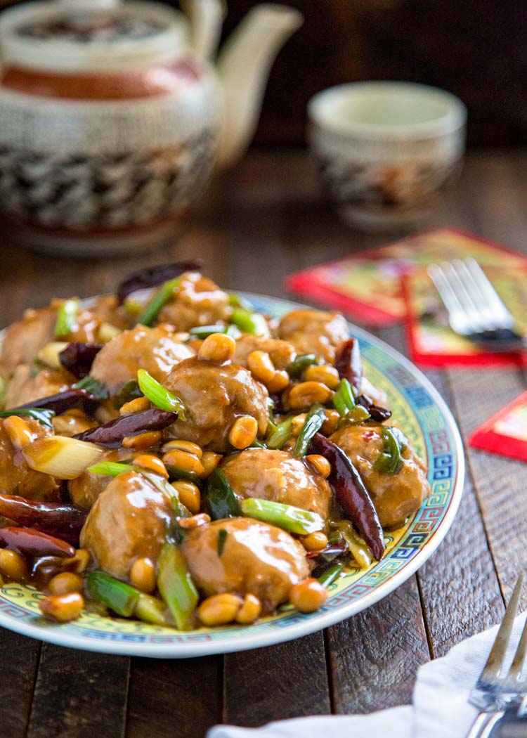These Kung Pao Chicken Meatballs are made with a bit of added peanut butter, chili paste in the chicken mixture and coated in a wonderfully authentic pan sauce. Off the hook tasty. keviniscooking.com