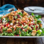 This Moroccan Salad with Za'atar Croutons is chok full of shredded carrots, chickpeas and other veggies and pomegranate, feta and toasted pine nuts, but the kicker is the lemon and cumin dressing that brings this all together. Topped with crunchy homemade za'atar spiced croutons and dinner is served! keviniscooking.com
