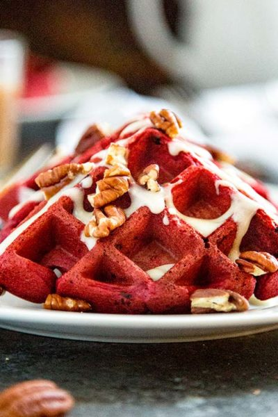 These Red Velvet Waffles with Cream Cheese Glaze are the perfect way to wake up your sweetie for Valentines Day breakfast or after a great dinner for dessert. These red chocolate fluffy waffles with a cream cheese glaze are a sure hit! keviniscooking.com
