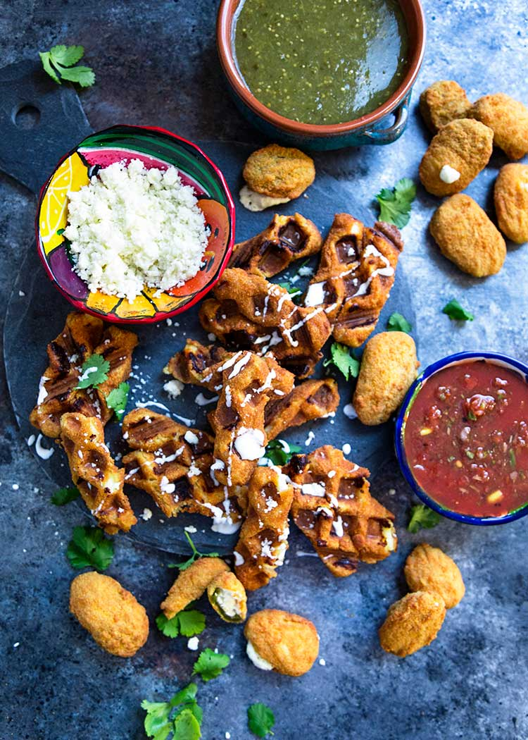 These Wafflized Mozzarella Sticks with Salsa start out with frozen mozzarella sticks that get the waffle treatment. More crunchy edges, more cooked cheese, these are perfect for dunking and eating for the big game day party! www.keviniscooking.com