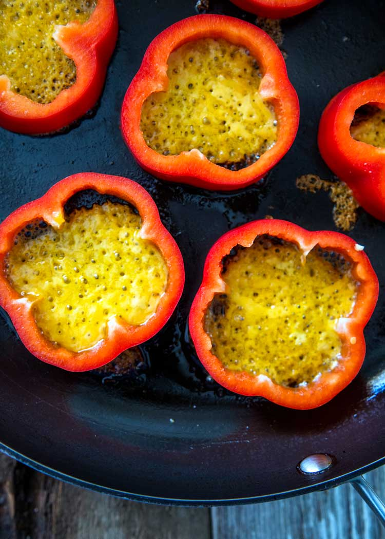These Breakfast Stuffed Peppers have beef, salsa, cheese and a beautiful egg to top off one hearty and delicious breakfast. You need this one, and making a batch for the family is easy! keviniscooking.com