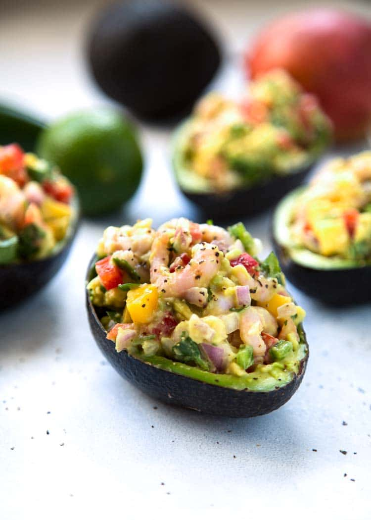 Easy, healthy and filled with shrimp, mango and crunchy vegetables, these Mango Shrimp Stuffed Avocado are a perfect appetizer or light lunch that's good for you. keviniscooking.com
