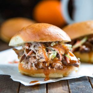 A close up of a southern pulled Pork and orange Sauce sandwich