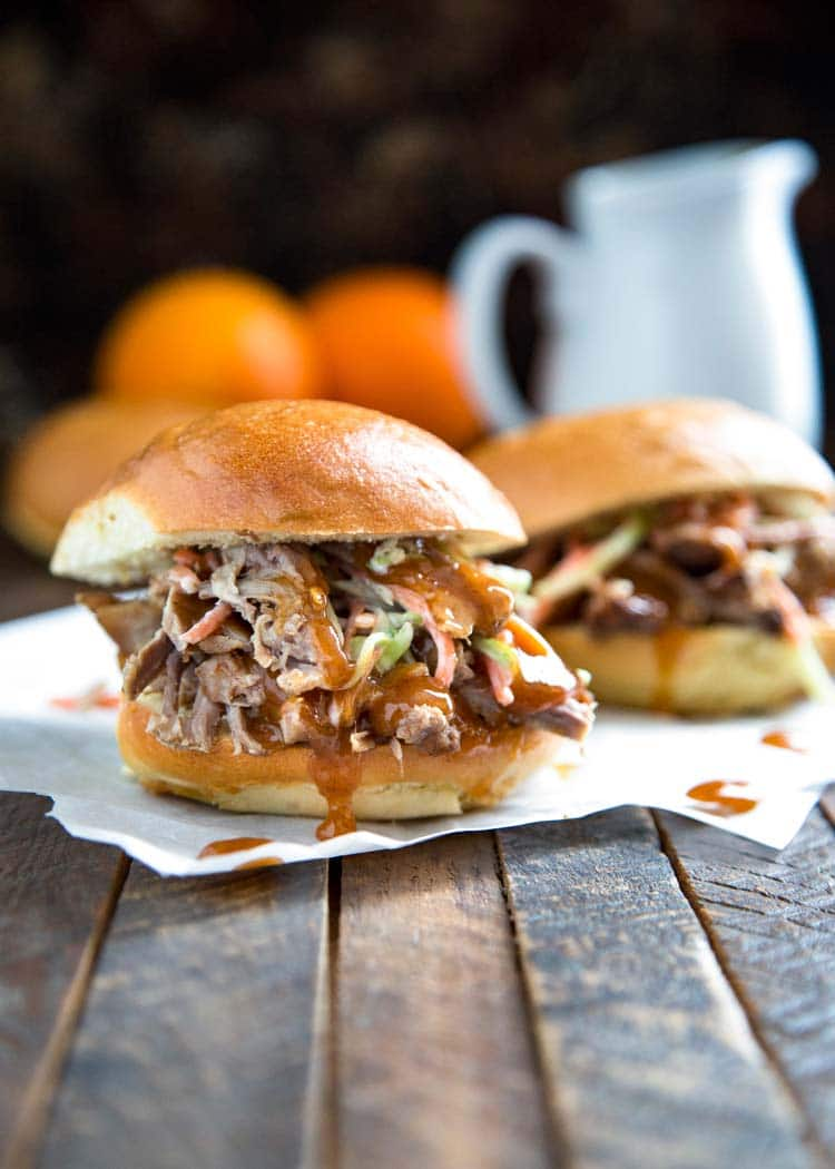 Southern Pulled Pork with Orange Sauce - marinated pulled pork served with an aromatic sauce made of orange juice, zest, cinnamon and cloves. Perfect with roasted vegetables or in a sandwich. This sauce is EVERYTHING. keviniscooking.com