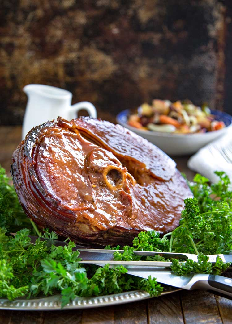 Perfect for a holiday table, this Spicy Citrus Baked Ham Glaze develops a wonderful, caramelized crust that's just mouthwatering using orange juice, cinnamon, clove and chipotle powder. keviniscooking.com