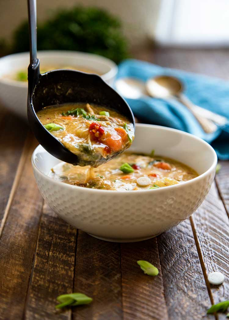 This Coconut Chicken Thai Soup with Pineapple uses a whole chicken simmered in coconut milk, cinnamon, lemon grass and sage. Kissed with a little heat from chili paste this soup is layered with soothing delicious flavors. keviniscooking.com