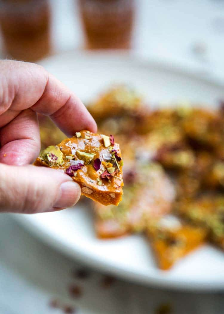 Persian Almond and Pistachio Brittle - Sweet and salty brittle gets a fun twist here with delicate Persian flavors like rose water, saffron and it's loaded with almonds and pistachios. keviniscooking.com