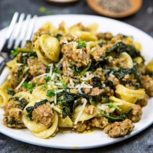 A close up of a plate of food with broccoli, with Orecchiette and Sausage