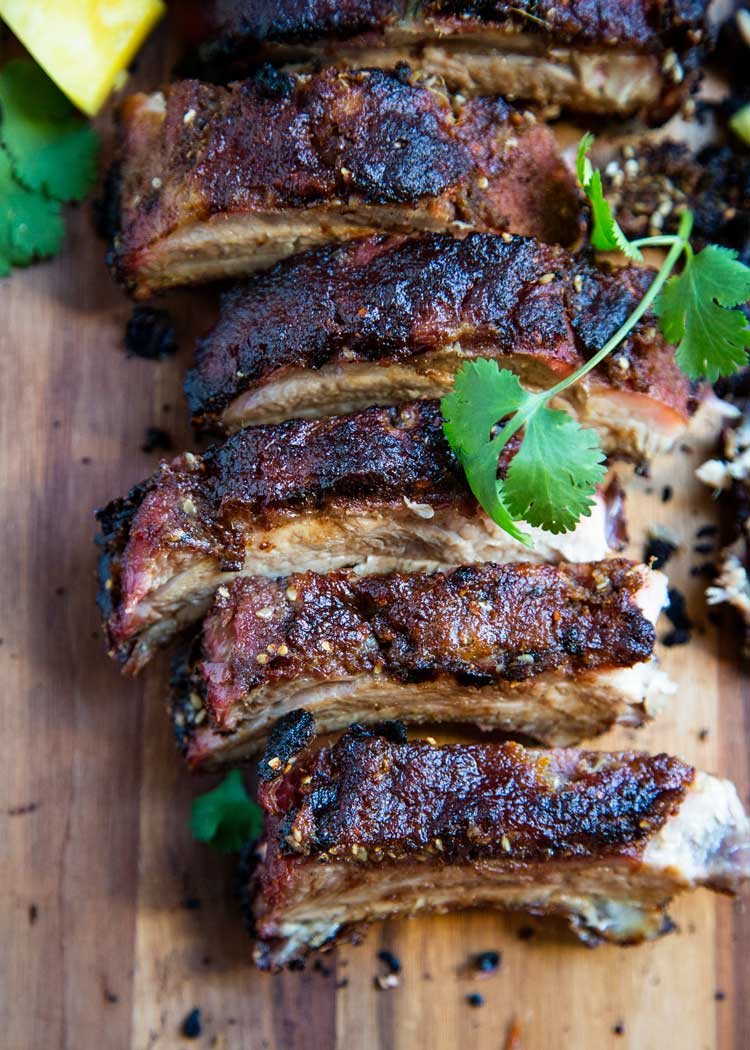 Pineapple Five Spice Pork Ribs get an Asian influence with Chinese Five Spice Powder, sesame oil , soy sauce, ginger, white pepper and pineapple. So good! keviniscooking.com