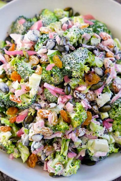 Tarragon Broccoli Salad with Golden Raisins, Marinated Red Onion and Pepitas - this fresh, crunchy and healthy salad is the perfect side dish! keviniscooking.com
